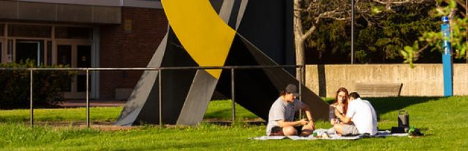 """Students Gathering Near """"Cock-A-Doodle-Do"""" Sculpture"""